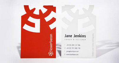 A set of business cards that are die cut into a unique shape
